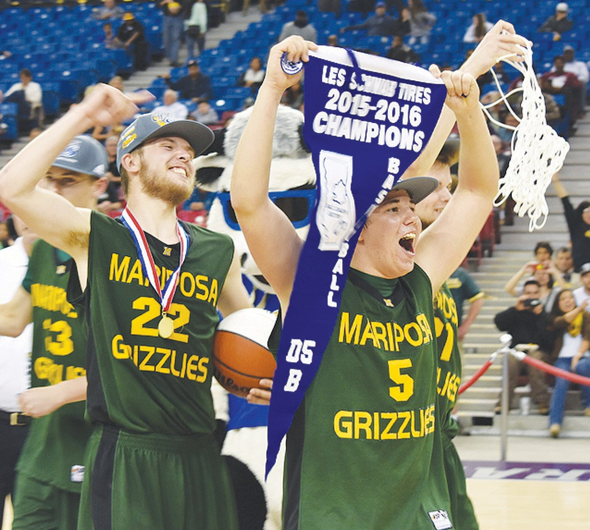 Mariposa seniors Brad Chambers (No. 5) and Dalton Rockwood (No. 22) proudly display the first-ever MCHS Sac- Joaquin Section basketball championship pennant. The Grizzlies whipped Brookside Christian of Stockton last Friday night at the Sleep Train Arena in Sacramento, 79-75, in overtime for the title. Rockwood dumped in a record-setting 35 points and Chambers added 19 to pace Mariposa. (See photographic dedication to the championship team on page A-7.)