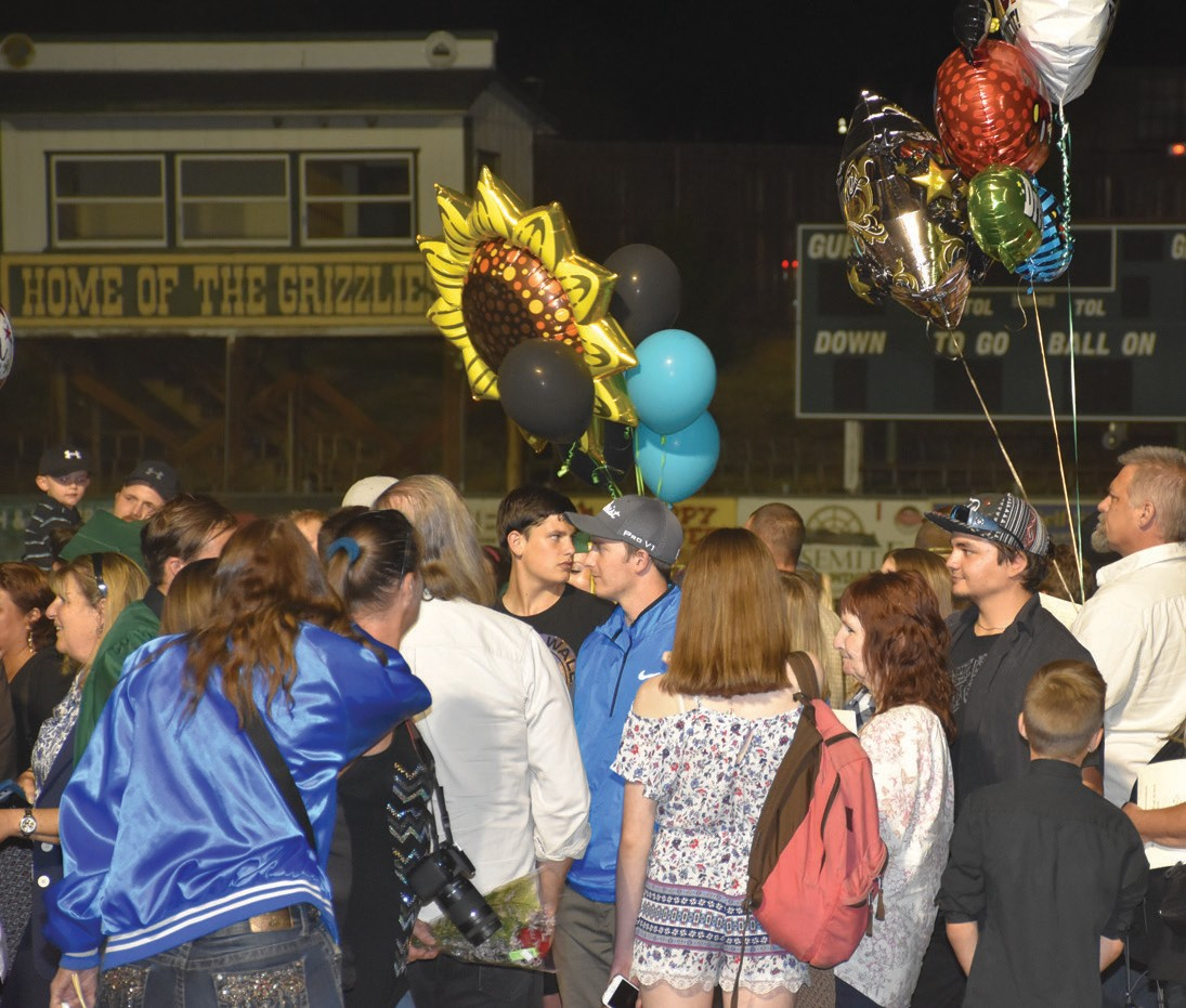Many parents and other loved ones gathered after commencement to congratulate their graduates with balloons and other gifts.