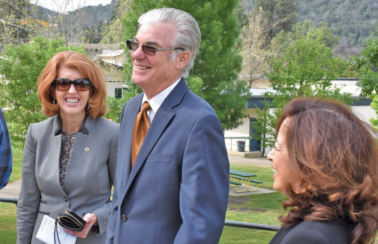 From left, superintendent Robin Hopper, left, enjoys a lighter moment with State Superintendent of Public Instruction, Tom Torlakson, and his wife, Mae.